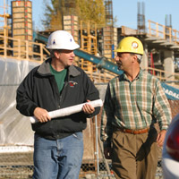 Rep. Les Gara during a meeting at a construction site