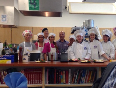 Rep. Gara with East High's culinary students