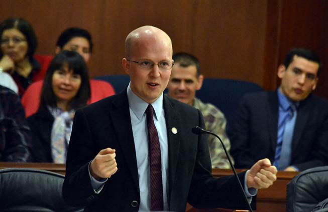 As supporters look on, Representative Jonathan Kreiss-Tomkins delivers closing remarks on the importance of Alaska Native languages on the floor of the Alaska state House of Representatives today, April 16, 2014.